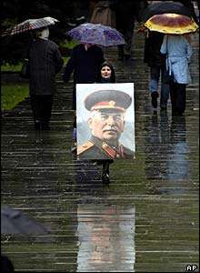 Woman in Kiev with wartime portrait of Stalin