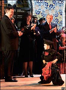 Georgian President Mikhail Saakashvili, left, and US President George Bush, right, watch traditional Georgian dancing