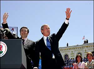 US President George W Bush (right) and Georgian President Mikhail Saakashvili wave to the crowd in Freedom Square, 10 May 2005