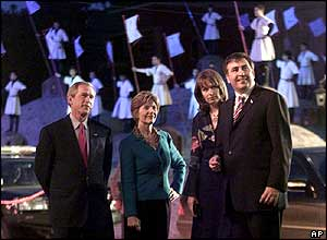 George W Bush and wife Laura stand with Georgian President Mikhail Saakashvili and his wife Sandra Roelofs