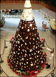 A chef puts finishing touches on a chocolate Christmas tree on display at a hotel in Bangkok, Thailand. The tree was measured at 5.40 meters (17.72 feet) high and used 200 kgs (440 pounds) of chocolate