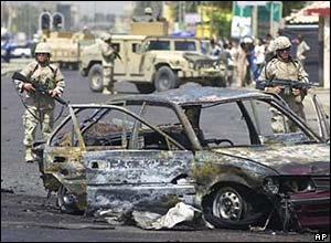 A US soldier near a car used in a bombing in the Yarmouk area of Baghdad