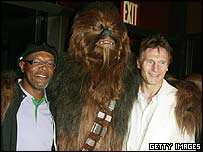 Chewbacca hugs his Star Wars co-stars Samuel L Jackson and Liam Neeson
