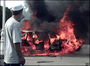 A car burning in the Uzbek town of Andijan