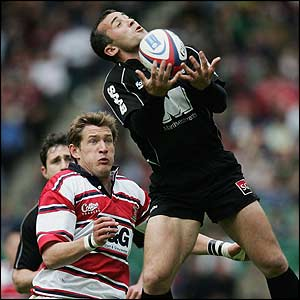 Saracens' Thomas Castaignede gathers the ball under pressure from James Forrester of Gloucester in the Zurich Wildcard final