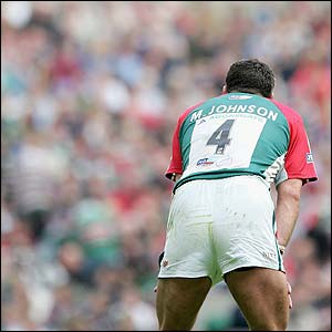 A dejected Martin Johnson contemplates defeat