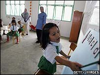 Indonesian pupils learn to read at a new school