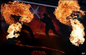 A Star Wars poster is set on fire