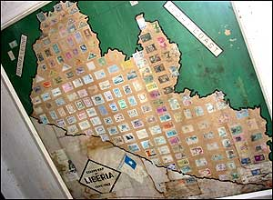 A collection of Liberian stamps on a Liberian map.