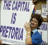 A woman holds up a sign during the rally