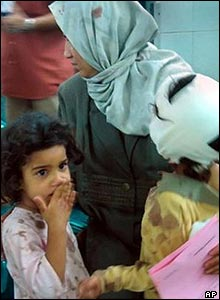 A girl watches as her brothers are treated in Baghdad's Yarmouk hospital