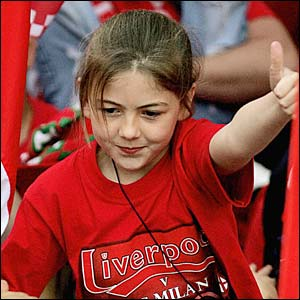 A girl sticks her thumb up at the Liverpool parade
