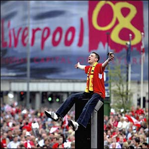 A Liverpool fan perches on a lamp post