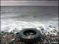 A tyre on a beach in Scotland