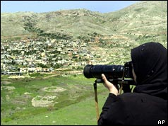 Syrian girl takes a photo of village on the occupied Golan Heights