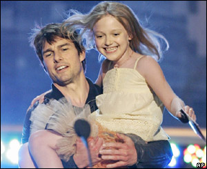 Tom Cruise carries Dakota Fanning onto the stage at the MTV movie awards in Los Angeles on Saturday