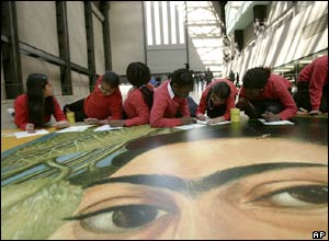 Children colour in giant poster of Frida Kahlo at the Tate Modern