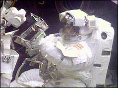 Astronaut carrying out repairs