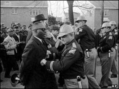 State trooper and demonstrator face each other on Selma-Montgomery march