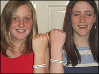 Kathryn and Clare show off their Make Poverty History white bands.