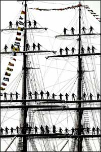 Crew stand in the rigging of a tall ship during rehearsal for The International Fleet Review, which will form part of the celebrations marking the 200th anniversary of the Battle of Trafalgar.