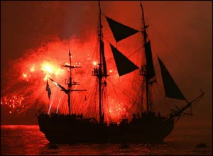 Red fire illuminates the Gran Turk in the Solent