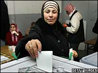 A Palestinian woman casts her vote in the election