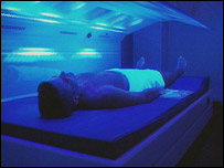 Man lying on a sunbed