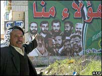 A man looks at a poster of Hamas election candidates
