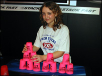 UK world champion Kate shows off her cup stacking skills.
