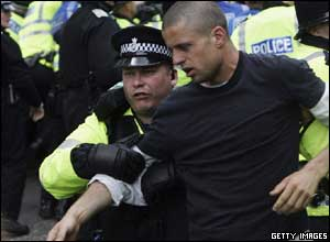 A protester is led away by police in the financial district of Edinburgh