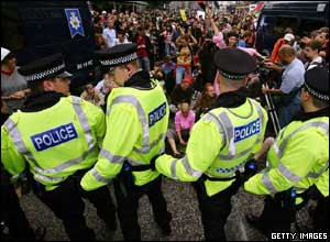 Police officers form a human chain as they try to contain demonstrators participating in the ' Carnival for Full Enjoyment