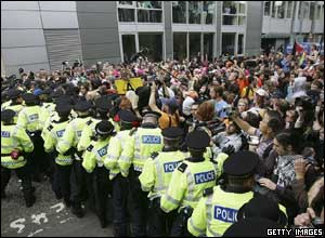 Protesters confront police in the financial district of Edinburgh