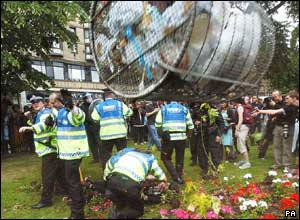 A litter bin hurled by a protester flies through the air towards police in Princes Street