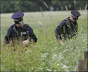 Police search a field