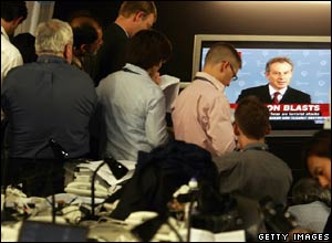 Journalists watch Tony Blair's announcement