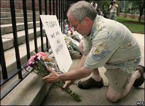 US citizen Geoffrey Forman, just back from a visit to London, places flowers on the steps of the British Embassy in Washington, DC