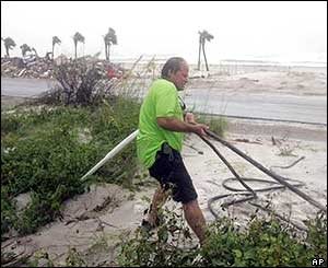 A Florida man works to secure a building on Pensacola Beach