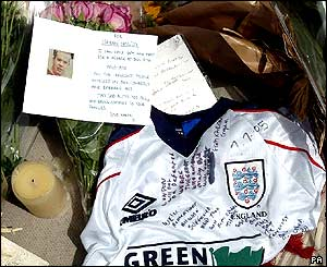 An England football shirt is left with a floral tribute to Ciaran Cassidy, who is missing following last week's London bombings, outside Kings Cross Station, London.