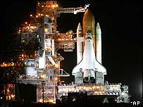 The service gantry is rolled back from Space Shuttle Discovery at Cape Canaveral