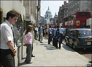 Office workers observe the silence in Fleet Street, central London