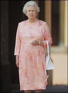 Queen Elizabeth II observes the silence in front of Buckingham Palace