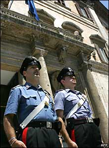 Carabinieri mark the two-minute silence outside the Italian parliament in Rome