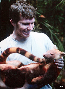Mammal expert Kris Helgen holds a golden-mantled tree kangaroo. It's the first record of the species in Indonesia.