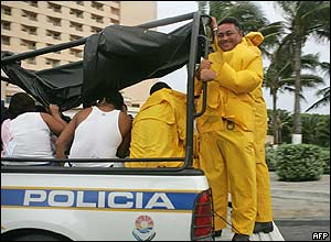 Police move people in Cancun.