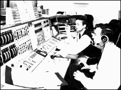 John Saxon (left) and Deputy Controller Mike Dinn (right) at the console