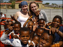 YK chilren helping at a British Red Cross project in South Africa (Picture: Giving Nation)