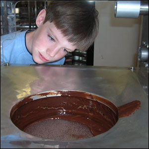 The chocolate slabs are carefully melted. Matthew takes a peek...
