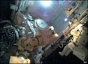 Soichi Noguchi and Steve Robinson left the shuttle so they could inspect it for damage which may need repairing