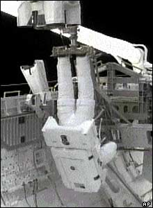 In this picture, Steve Robinson can be seen suspended from Discovery's robotic arm